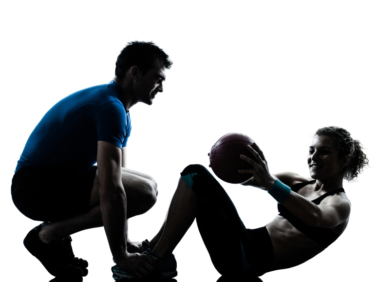 man woman exercising weights workout fitness ball